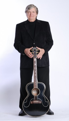 Phil Everly with his guitar